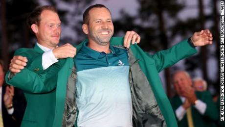 AUGUSTA, GA - APRIL 09:  Danny Willett of England presents Sergio Garcia of Spain with the green jacket after Garcia won in a playoff during the final round of the 2017 Masters Tournament at Augusta National Golf Club on April 9, 2017 in Augusta, Georgia.  (Photo by Andrew Redington/Getty Images)