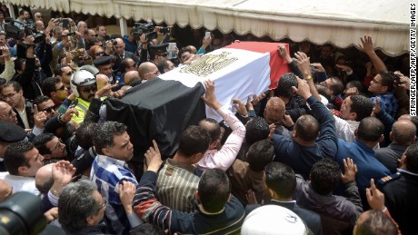 Egyptians carry the coffin of policewoman Brigadier Nagwa el-Haggar during her funeral on April 10, 2017, after she died during a blast that struck outside the Coptic Orthodox Patriarchate headquarters in the Mediterranean city of Alexandria on Palm Sunday the day before. Egypt prepared to impose a state of emergency after jihadist bombings killed dozens at two churches in the deadliest attacks in recent memory on the country's Coptic Christian minority. / AFP PHOTO / STRINGER        (Photo credit should read STRINGER/AFP/Getty Images)