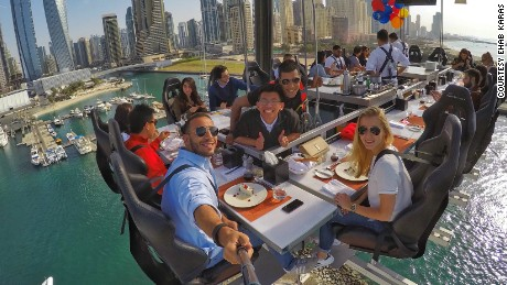 These diners at Dinner in the Sky UAE look happy -- but how about the rest of Dubai?