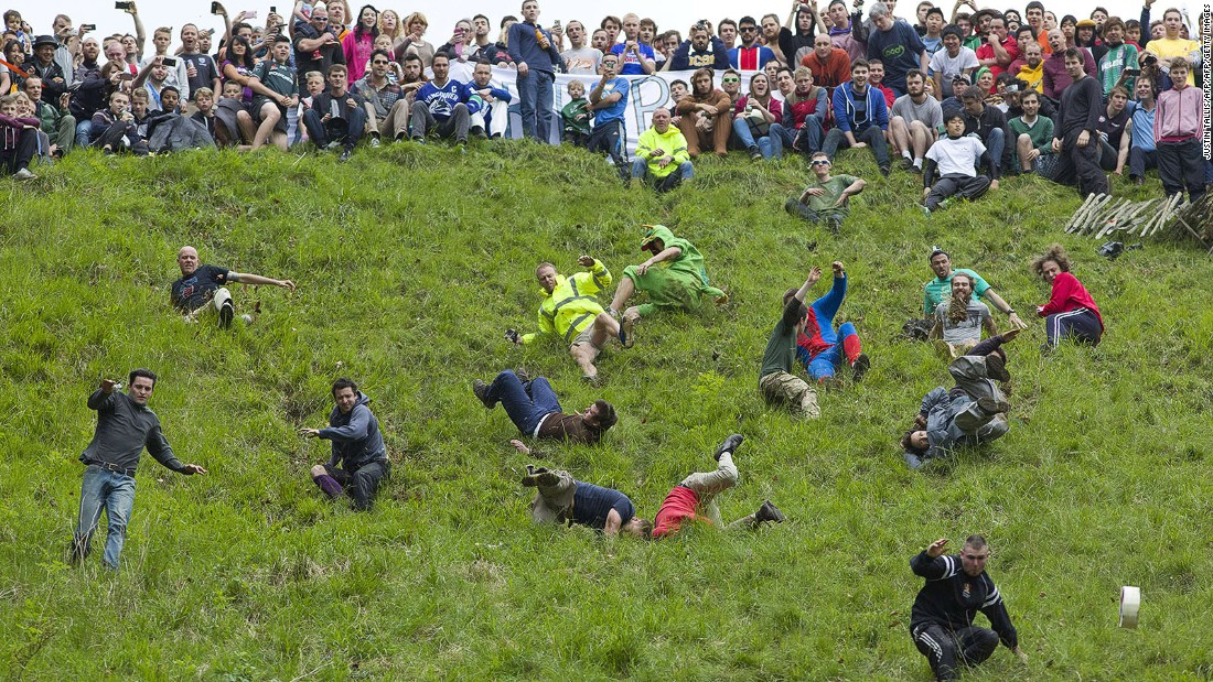 <strong>Cheese-rolling at Coopers Hill in Gloucestershire (England): </strong>Where tumbling down a very steep and rugged hill after a spinning, rolling, bouncing Double Gloucester cheese is serious business.