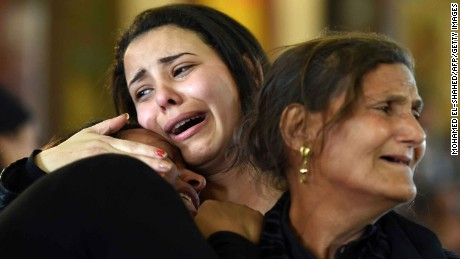 Women mourn for the victims of the blast at the Coptic Christian Saint Mark's church in Alexandria during a funeral on April 10, 2017.