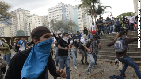 Opposition activists clash with riot police in Caracas on April 10, 2017.  Venezuela's political crisis intensified last week when the Supreme Court issued rulings curbing the powers of the opposition-controlled legislature. The court reversed the rulings days later, but the opposition intensified its protests from that moment.  / AFP PHOTO / FEDERICO PARRA        (Photo credit should read FEDERICO PARRA/AFP/Getty Images)
