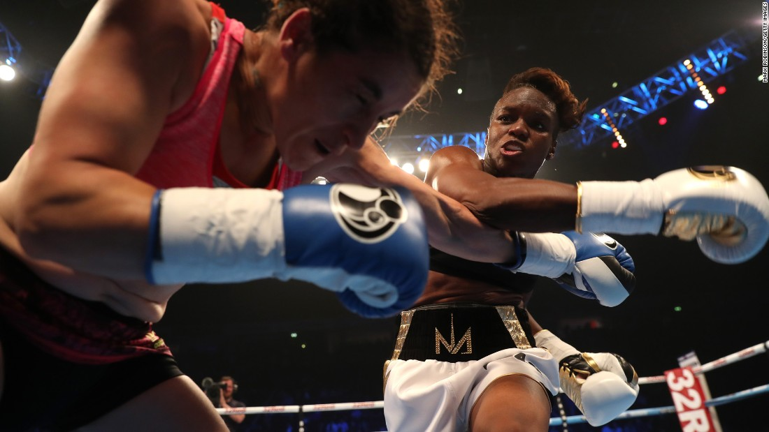 Nicola Adams throws a punch at Virginia Noemi Carcamo during their flyweight boxing bout in Manchester, England, on Saturday, April 8. It was the professional debut for Adams, a two-time Olympic gold medalist from England. She won on points.