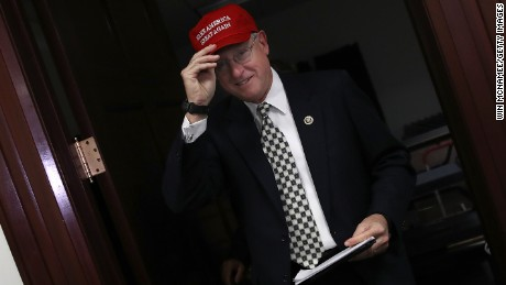 "Rep. Mike Conaway (R-TX) adjusts his ""Make America Great Again"" hat while leaving a meeting at the US Capitol November 15, 2016 in Washington, DC."