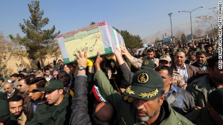 "Members of the Iranian Revolutionary Guard carry the caskets of Brigadier General Mohsen Ghajarian and other Iranian ""volunteers"" killed in Aleppo during their funeral procession in Tehran, in 2016."