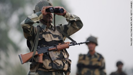 Qn Indian Border Security Force (BSF) soldier looks through a binocular towards Pakistan during a patrol at the India-Pakistan border in R.S Pora, southwest of Jammu, on October 3, 2016. / AFP / TAUSEEF MUSTAFA        (Photo credit should read TAUSEEF MUSTAFA/AFP/Getty Images)