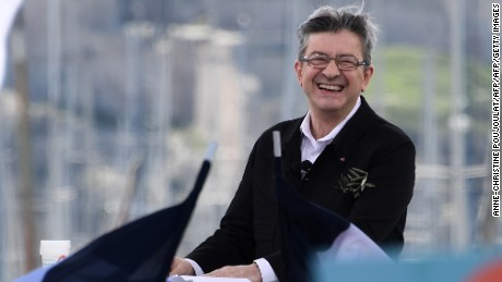 French presidential election candidate for the far-left coalition La France insoumise Jean-Luc Melenchon smiles as he delivers a speech during a public meeting at the Old Port of Marseille, southern France, on April 9, 2017. / AFP PHOTO / Anne-Christine POUJOULAT        (Photo credit should read ANNE-CHRISTINE POUJOULAT/AFP/Getty Images)
