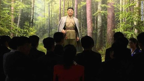 North Koreans observe a statue of their founder Kim Il Sung at the Museum of the Korean revolution. It's the first time CNN cameras have been allowed inside.