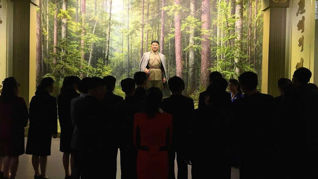 North Koreans observe a statue of their founder, Kim Il Sung, at the Museum of the Korean Revolution on Monday, April 10. CNN's Will Ripley says its the first time CNN cameras have been allowed into the Pyongyang museum.