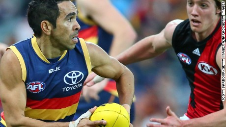 Eddie Betts of the Crows runs with the ball during a match between the Adelaide Crows and the Essendon Bombers