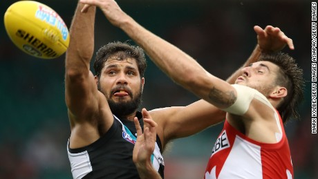 Paddy Ryder of the Power and Sam Naismith of the Swans compete for the ball during the round one AFL match between the Sydney Swans and the Port Adelaide Power