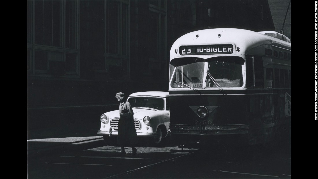 "A woman crosses a Philadelphia street in this photo taken in 1963 by Ray K. Metzker, a renowned photographer whose work can be found in dozens of art museums across the world. Sixty of Metzker's prints can be seen in <a href=""http://www.lesdoucheslagalerie.com/fr/expositions/presentation/18/abstractions#oeuv-20"" target=""_blank"">""Abstractions,""</a> an exhibit at Les Douches Gallery in Paris. ""Metzker holds a special place in the history of American photography,"" according to Les Douches Gallery. ""His work, consisting exclusively of black and white images, is completely representative of an entire generation of profoundly experimental photographers."""