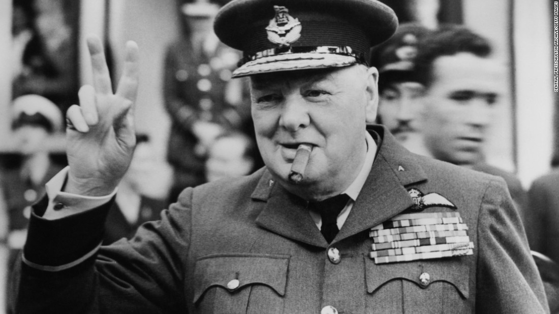 "Winston Churchill flashing his famous ""V for victory"" sign in Croydon, England in 1948."