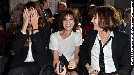 Lou Doillon, Charlotte Gainsbourg and Jane Birkin attend the Saint Laurent show at Paris Fashion Week in September, 2016