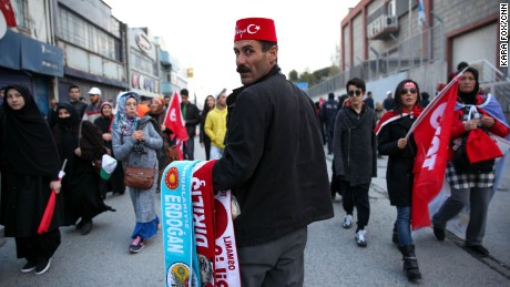"A vendor selling scarves with President Tayyip Erdogan's name on them at a rally for the ""yes"" vote in Istanbul's Yenikapi Square on Saturday, April 8, 2017."
