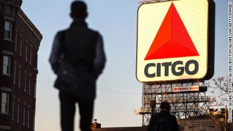 BOSTON, MA - FEBRUARY 27: Pedestrians walk through Kenmore Square as sunlight falls on the Citgo sign in Boston on Feb. 27, 2017. Citgo and Related Beal, the New York developer that owns the building where the sign sits, are currently locked in negotiations over how much Citgo should pay to rent the sign's perch. (Photo by Keith Bedford/The Boston Globe via Getty Images)