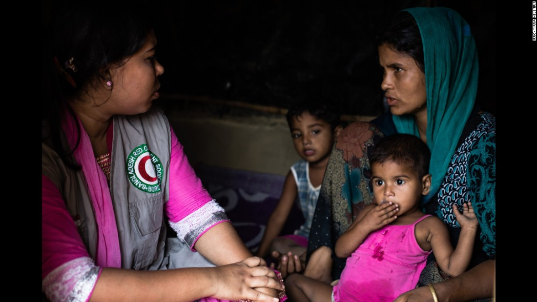 Rabeya, 25, talking with the Bangladesh Red Crescent volunteer trained in psychosocial support in the makeshift Balukhali camp in Ukhiya, Cox's Bazar district, south eastern Bangladesh on 8 April, 2017.