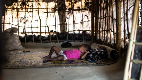 Bangladesh. Cox's Bazar district, 2017.    Rabeya's daughter, 2 years, sleeps inside of their temporary shelter  in the makeshift Balukhali camp in Ukhiya, Cox's Bazar district, south eastern Bangladesh on 8 April, 2017.  Since October 2016, almost 75,000 people have fled violence in the northern area of Rakhine State in neighbouring Myanmar and arrived in Bangladesh. Many are living in unplanned and overcrowded settlements in the district of Cox's Bazar where living conditions are extremely poor. On 20 March 2016, the International Federation of Red Cross and Red Crescent Societies (IFRC) launched a 3.2 million Swiss Francs emergency appeal in support of the Bangladesh Red Crescent Society's efforts to address the most urgent humanitarian needs of the newly arrived migrants in Cox's Bazar. The appeal seeks to ensure that 25,000 of the new arrivals will receive food aid and other emergency relief items, including shelter materials, together with clean water, sanitation, psychosocial support and health care over a nine month period. Photo: Mirva Helenius / IFRC