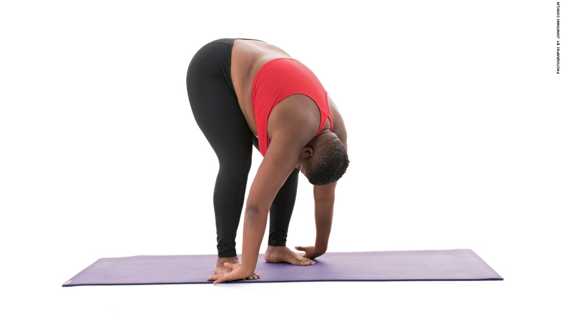"<strong>Standing forward fold: Uttanasana</strong> ""On the exhale, fold forward from your hips as you draw your arms, hands and heart to the floor,"" Stanley says. ""Keep your hips stacked over your knees. Relax your shoulders. Let your neck hang long and loose."""