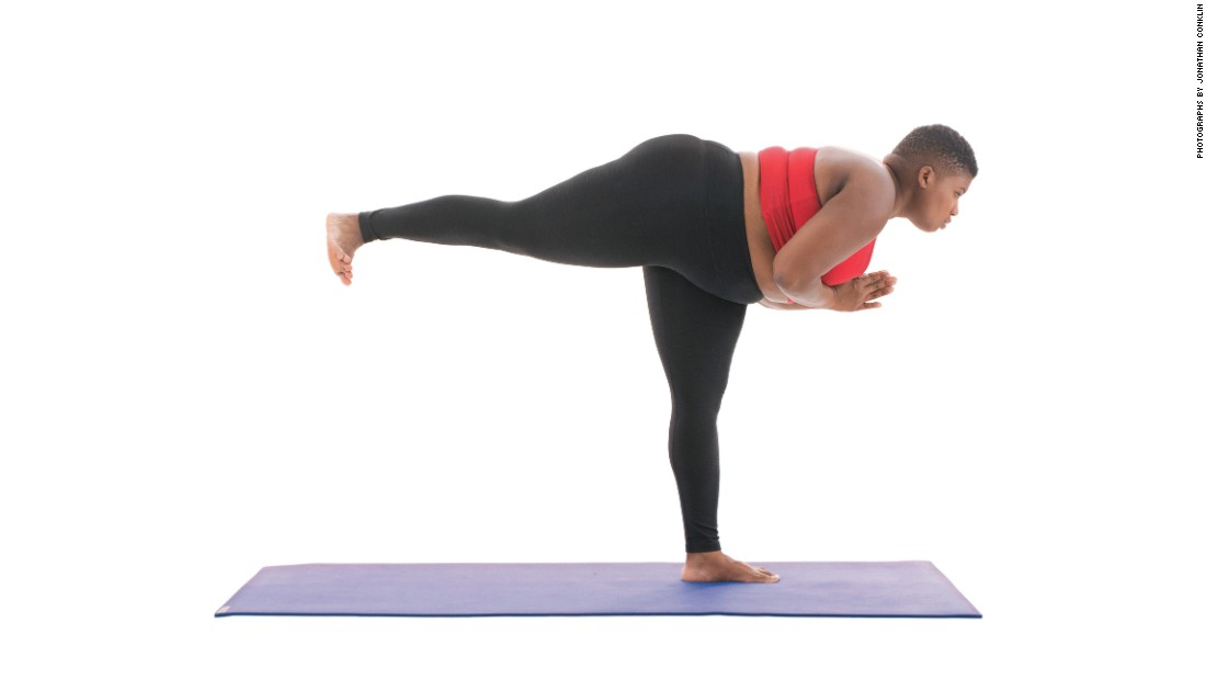 "<strong>Warrior III: Virbhadrasana III </strong>In this pose, Stanley tells readers to ""Flex VERY actively through all ten of your toes, pressing into the big toe of your standing leg. Square your hips forward and spin your back toes to the floor or as close as possible."" She says to focus your gaze forward to help with your balance."