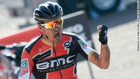 Belgium's Greg Van Avermaet celebrates as he crosses the finish line at the end of the 115th edition of the Paris-Roubaix one-day classic cycling race, between Compiegne and Roubaix, on April 9, 2017 in Roubaix, northern France. / AFP PHOTO / François LO PRESTI        (Photo credit should read FRANCOIS LO PRESTI/AFP/Getty Images)