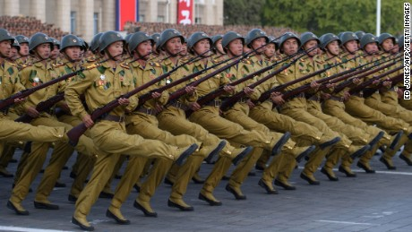 North Korean soldiers march during a mass military parade at Kim Il-Sung square in Pyongyang on October 10, 2015. North Korea was marking the 70th anniversary of its ruling Workers' Party. AFP PHOTO / Ed Jones        (Photo credit should read ED JONES/AFP/Getty Images)