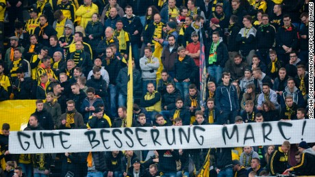 "Dortmund fans displayed a banner reading ""Get well Marc"" in the stands to their injured Spanish defender"