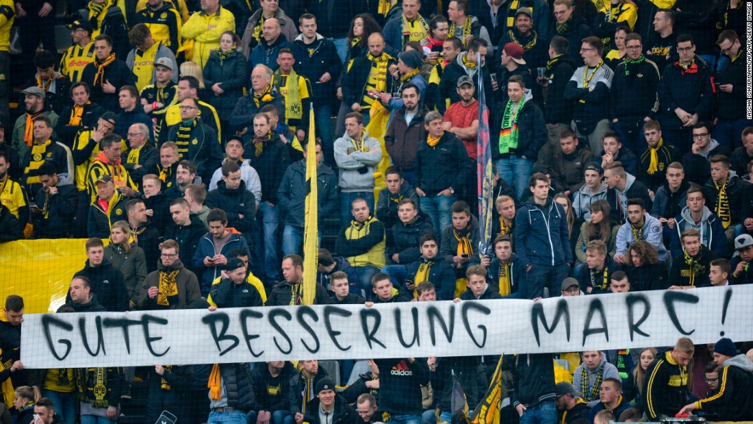 "Dortmund fans displayed a banner with a message to their Spanish defender, who underwent surgery on his injured arm and hand, which read ""Get well Marc."""
