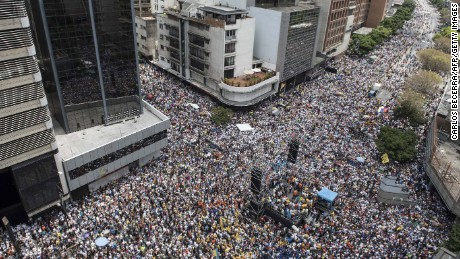 "Thousands of demonstrators protesting against President Nicolas Maduro's government march in Caracas on April 8, 2017. The opposition is accusing pro-Maduro Supreme Court judges of attempting an internal ""coup d'etat"" for attempting to take over the opposition-majority legislature's powers last week. The socialist president's supporters held counter-demonstrations on Thursday, condemning Maduro's opponents as ""imperialists"" plotting with the United States to oust him."