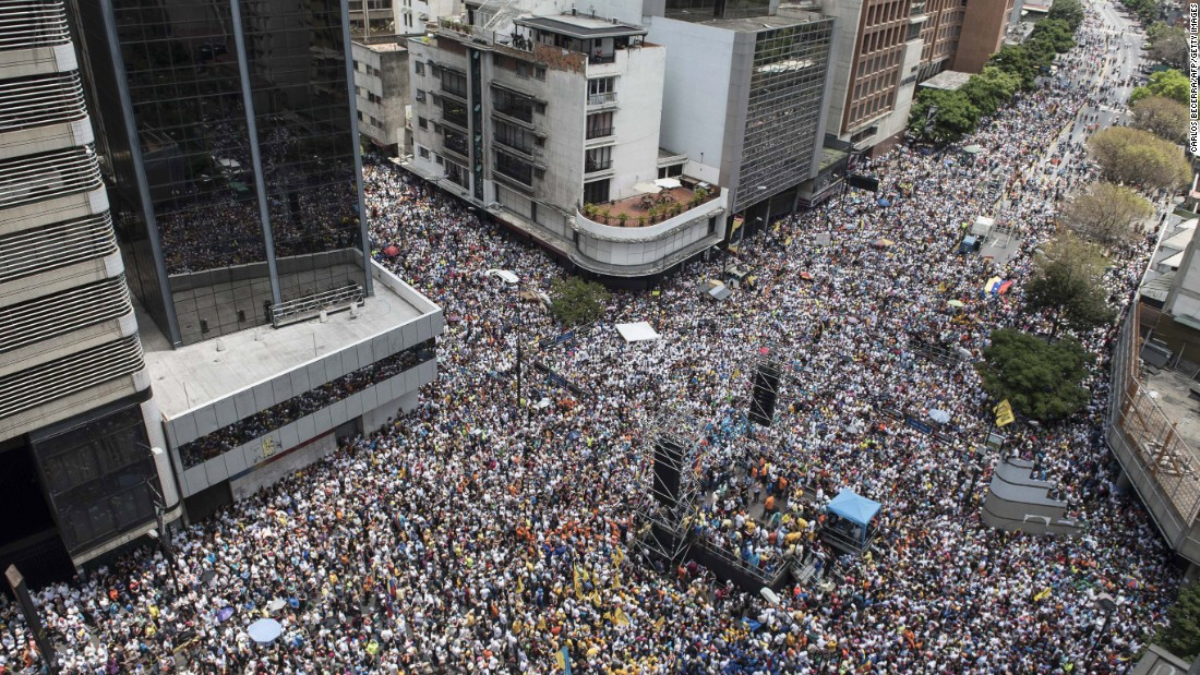 "Thousands of demonstrators protesting President Nicolas Maduro's government march on Saturday, April 8, in Caracas. The opposition accused pro-Maduro Supreme Court judges of attempting an internal ""coup d'etat"" when they tried days earlier to take over the opposition-majority legislature's powers."