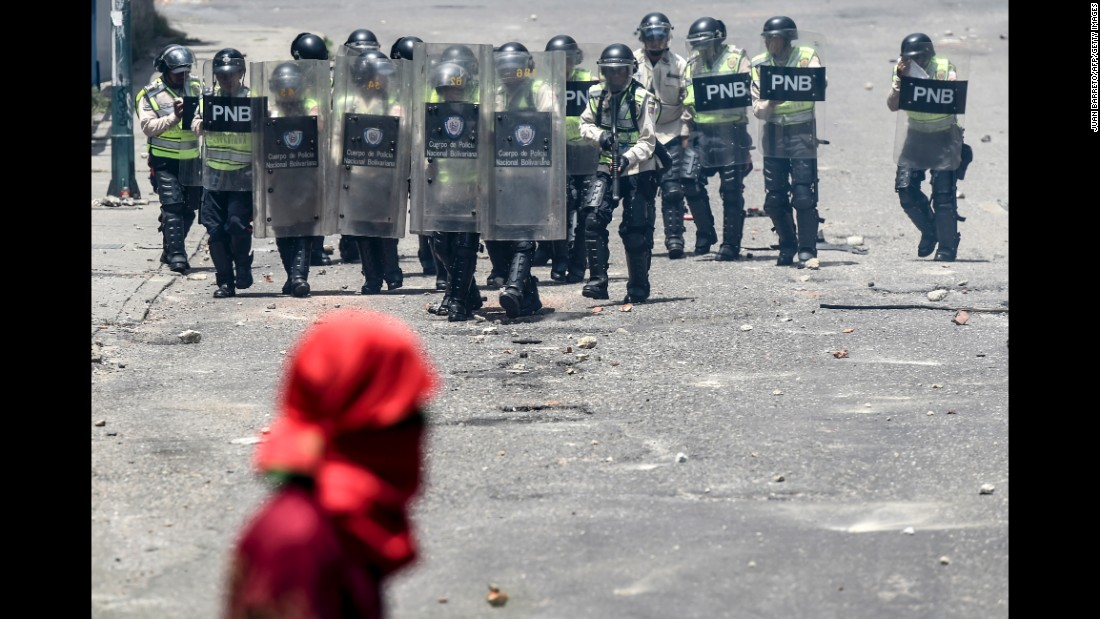 Venezuelan police line up before clashing with opposition activists during a protest on Thursday, April 6, against the Maduro government in Caracas.