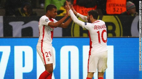 Striker Kylian Mbappe celebrates with Bernardo Silva after scoring the first of his two goals against Dortmund