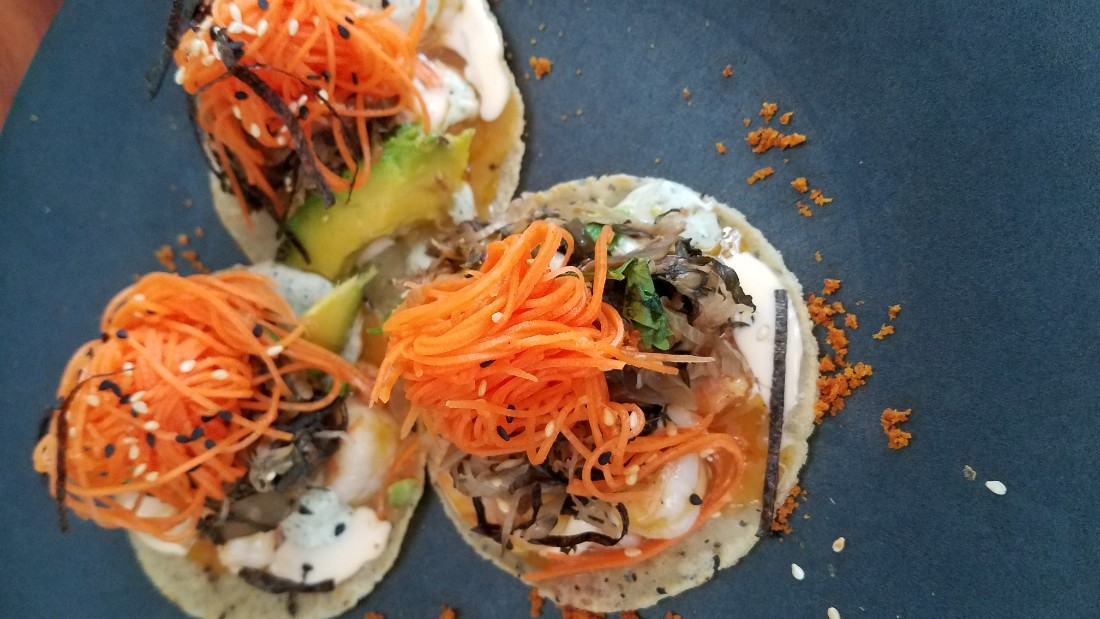 "<strong>Carmen</strong>: ""Tacos Caribe"" is an appetizer full of flavor with grilled shrimp, kimchi & toasted nori."