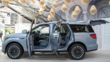 In this Tuesday, April 11, 2017, photo, the 2018 Lincoln Navigator is on display during a media preview in New York. Ford Motor Co.'s Lincoln luxury brand is making a play for a General Motors stronghold, revamping the Navigator truck-based SUV so it can better compete with the Cadillac Escalade and other big GM people haulers. (AP Photo/Mary Altaffer)