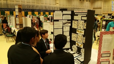 Stephen discusses his project with other students at the science fair.