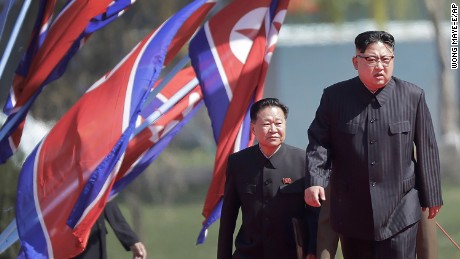 North Korean leader Kim Jong Un, right, arrives for the official opening of the Ryomyong residential area, a collection of more than a dozen apartment buildings, Thursday, April 13, 2017, in Pyongyang, North Korea. (AP Photo/Wong Maye-E)