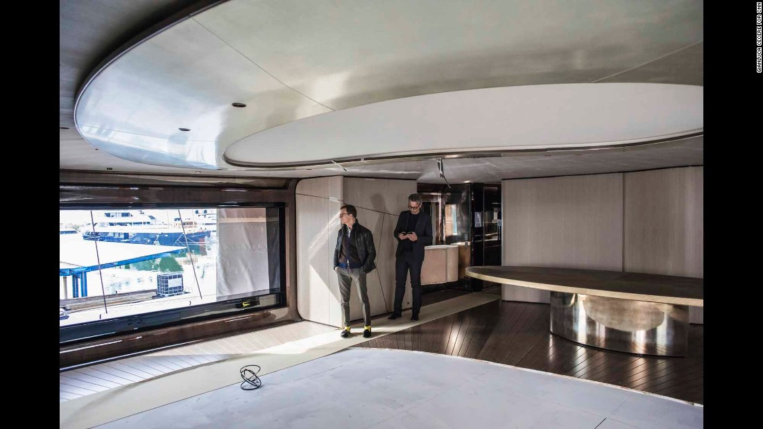 Architect and interior designer Achille Salvagni and Rossinavi COO Federico Rossi survey the Aurora; interior elements will be put in place once the ship is in the water.