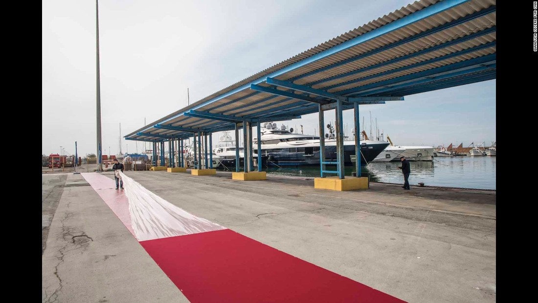 A dockside red carpet is rolled out the morning of the launch.