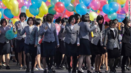 North Korean university students carry balloons as they gather at the Ryomyong residential area, a collection of more than a dozen apartment buildings, to attend its official opening ceremony on Thursday, April 13, 2017, in Pyongyang, North Korea. (AP Photo/Wong Maye-E)