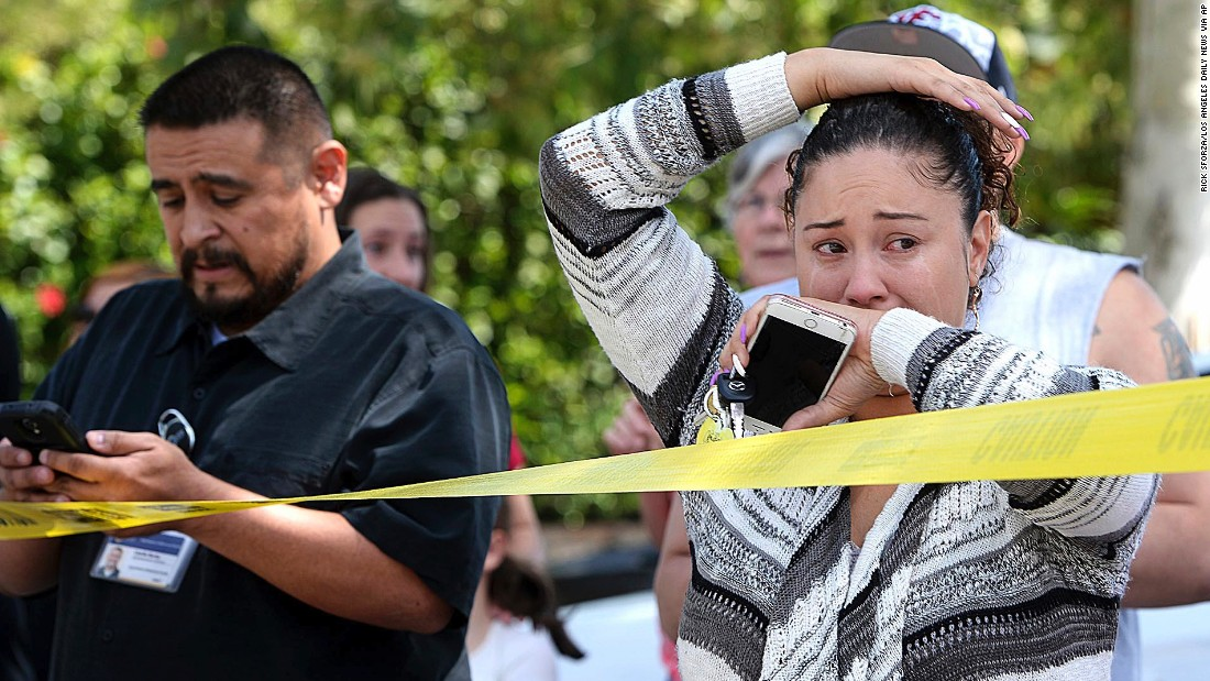 "People wait to hear from their children after <a href=""http://www.cnn.com/2017/04/11/us/san-bernardino-school-shooting/"" target=""_blank"">a fatal shooting at an elementary school</a> Monday, April 10, in San Bernardino, California. Police say a 53-year-old man shot his wife and a student before killing himself. Another student was shot but expected to survive."