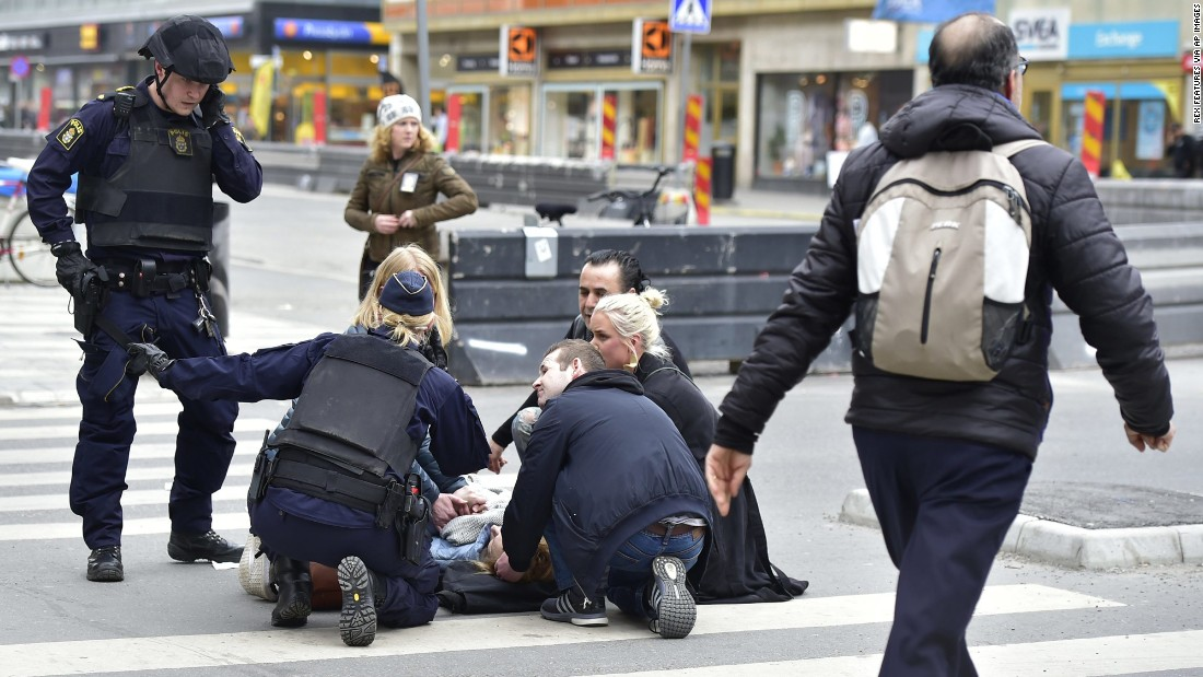 "A person receives medical attention after <a href=""http://www.cnn.com/2017/04/11/europe/stockholm-terror-attack-rakhmat-akilov/"" target=""_blank"">a truck hit pedestrians</a> in Stockholm, Sweden, on Friday, April 7."