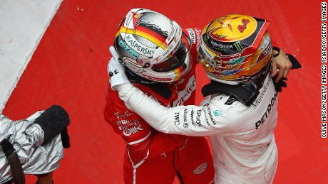 SHANGHAI, CHINA - APRIL 09:  Race winner Lewis Hamilton of Great Britain and Mercedes GP embraces second placed finisher Sebastian Vettel of Germany and Ferrari in parc ferme during the Formula One Grand Prix of China at Shanghai International Circuit on April 9, 2017 in Shanghai, China.  (Photo by Clive Mason/Getty Images)