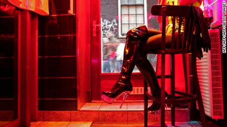 A sex worker waits for business in a window in Amsterdam's Red Light District.