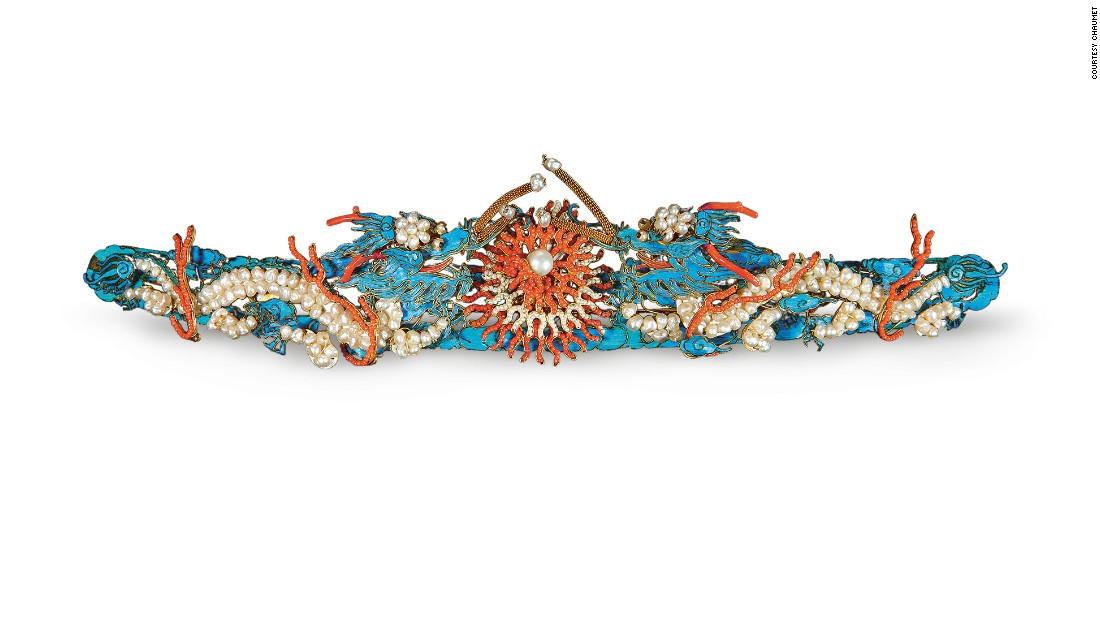 The show juxtaposes Chaumet's jewels with imperial works from the Palace Museum, such as this Qing dynasty double-dragon hair pin, set in gilded and colored silver, pearls, coral and glass.