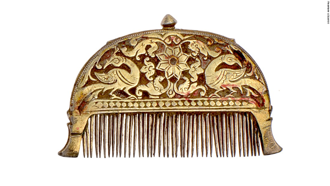 The collection also includes historic personal objects, such as this Kanghi comb from Rajasthan's Kota and Bundi regions. Carved with peacock and plant motifs, the hollowed, silver and gilt-gold piece doubled as a hair oil dispenser. (The comb was filled through the top screw-knob.)