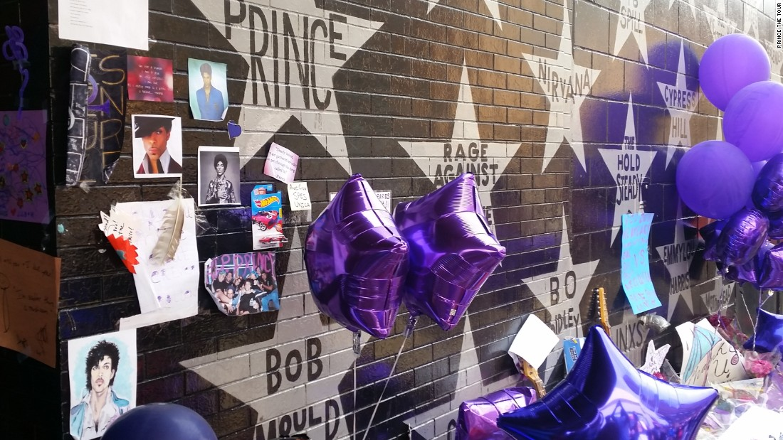 <strong>First Avenue star wall -- </strong>Outside, silver stars bear the names of past performers. A shrine has been started by Prince's name.