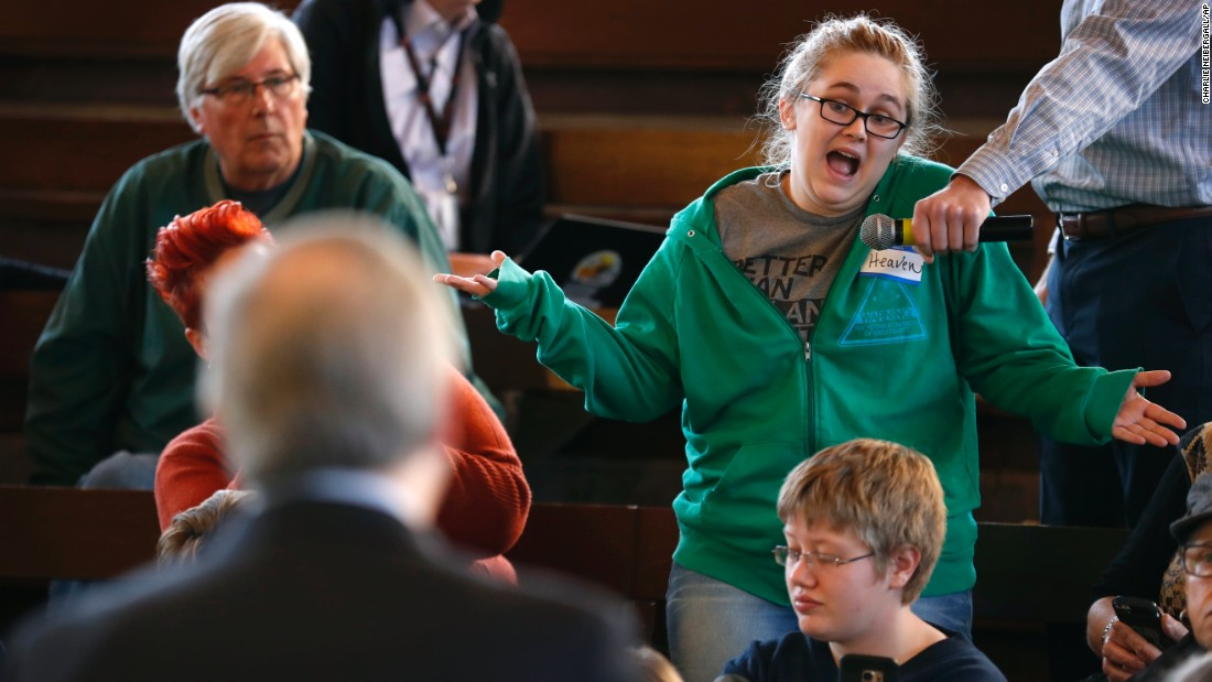 "Heaven Chamberlain asks US Rep. David Young a question during a town-hall meeting in Des Moines, Iowa, on Wednesday, April 12. With Congress on recess, <a href=""http://www.cnn.com/2017/04/11/politics/town-halls-tuesday-congress-on-break/index.html"" target=""_blank"">many lawmakers met with their constituents</a> to discuss a range of issues."