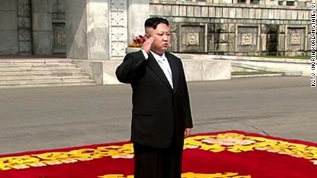 Kim Jong Un walks on the red carpet before the parade.