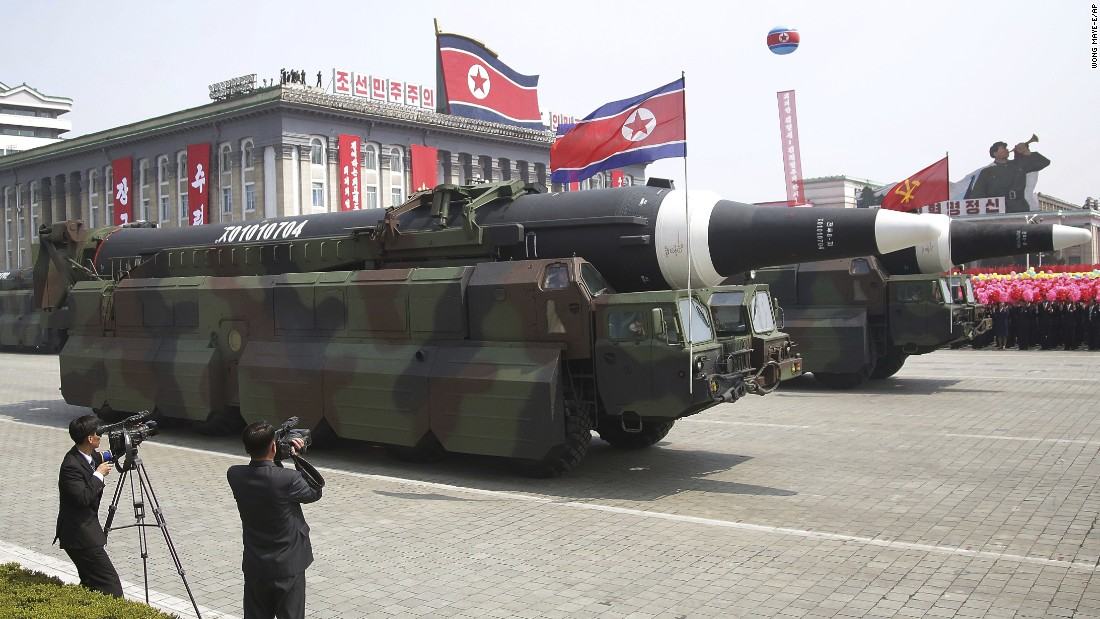 Missiles are paraded across Kim Il Sung Square.