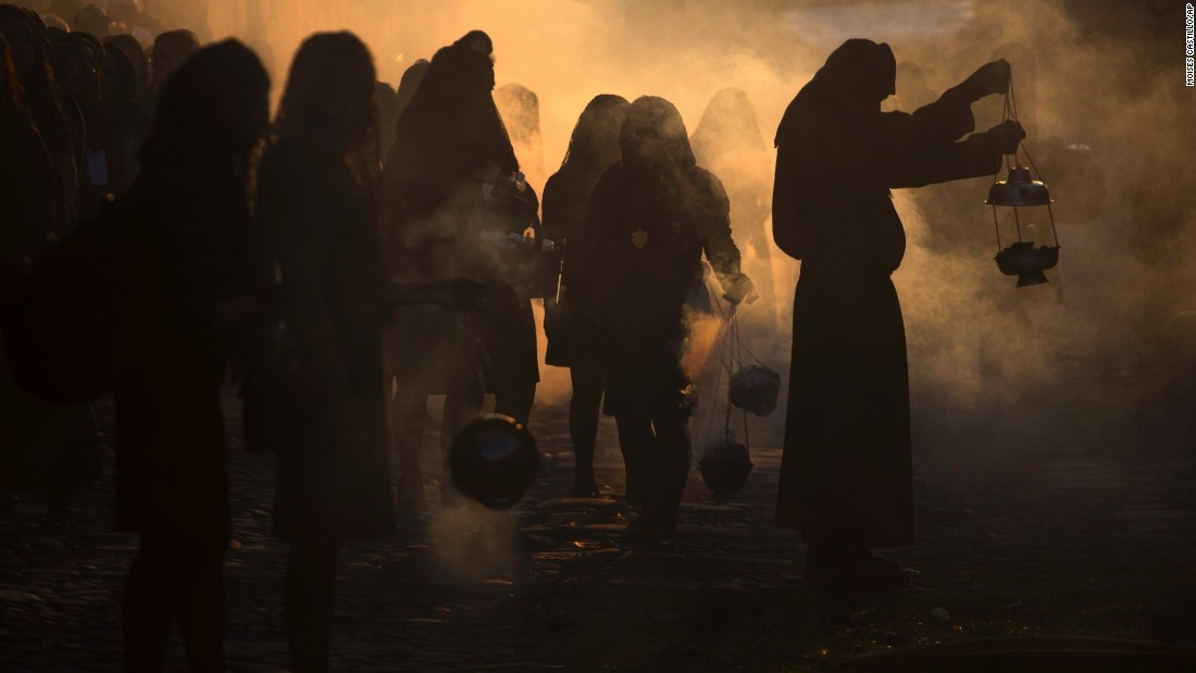 Penitents from a Catholic Church burn incense during a procession through the streets of Antigua, Guatemala, on Friday, April 14. Christians around the world are observing Holy Week, which marks the last week of Lent and the beginning of Easter celebrations.